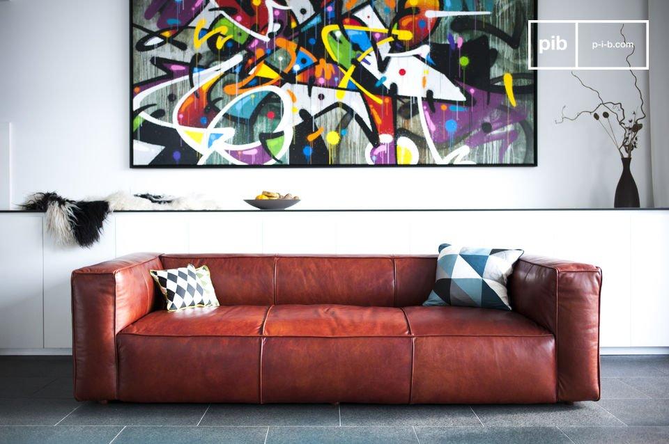 Entièrement couvert de cuir pleine fleur, le canapé Krieger affiche un look vintage sobre et élégant