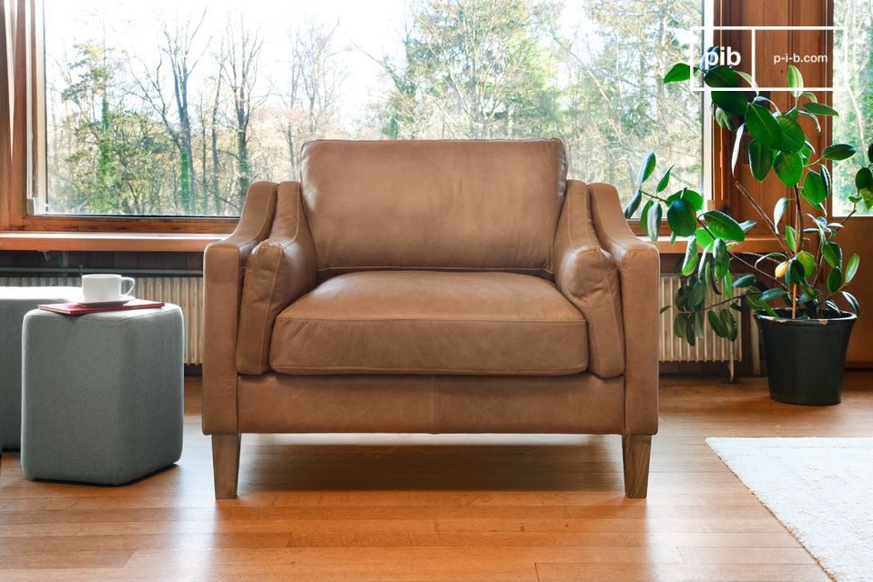 Un élégant fauteuil sable 100% cuir pleine fleur