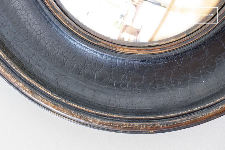Un beau miroir cylindrique à larges bords patinés